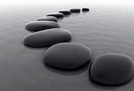 Zen stones in curved line in water