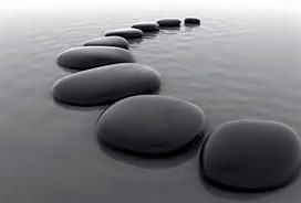 Zen stones in curved line in water