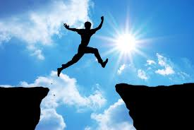 Person jumping ledge to ledge
